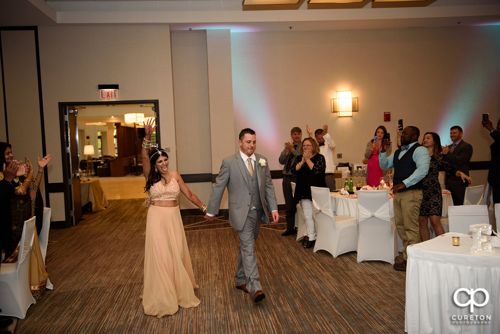 Bride and groom entrance into the reception.