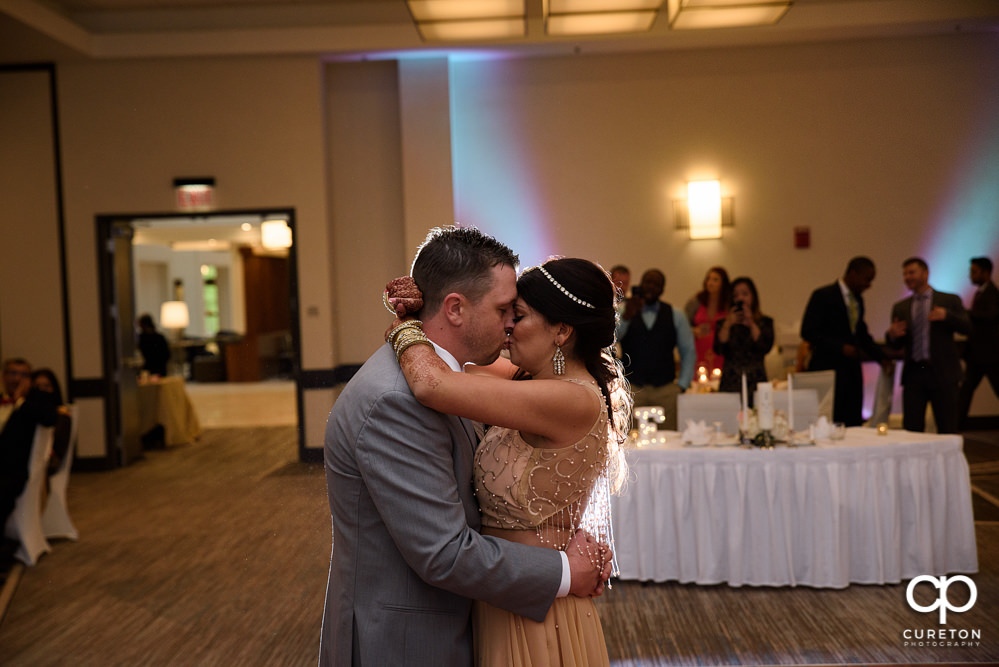 Bride and groom share a first dance at the wedding reception at Embassy Suites in Greenville.