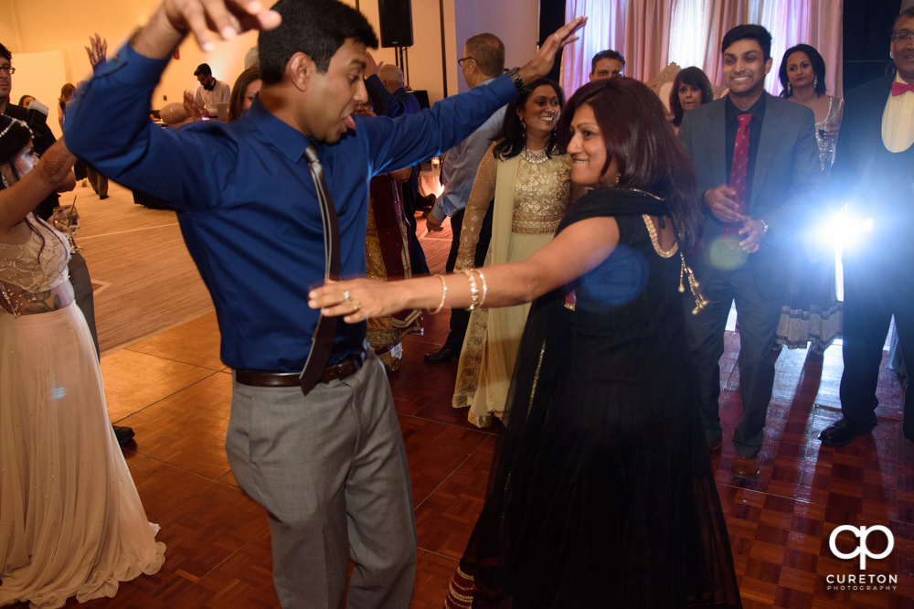 Wedding guests dancing at the reception.