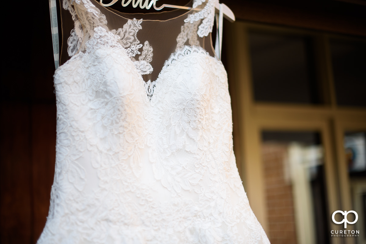 Detail on the bride's wedding dress.