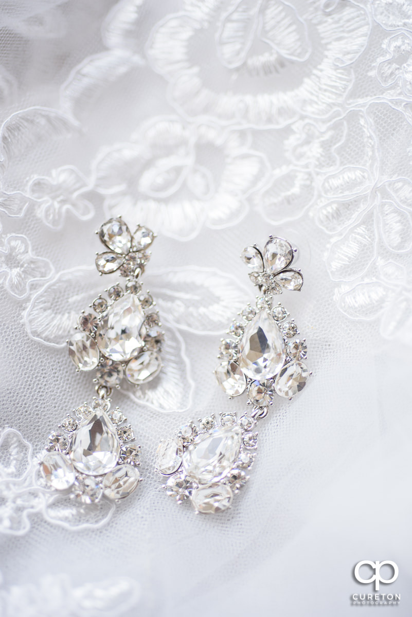 Bride's earrings on her veil.