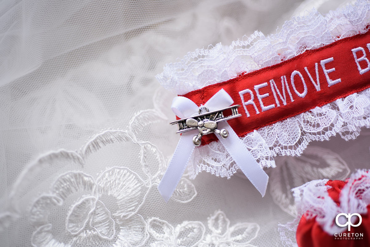 Airplane charm on the bride's garter.