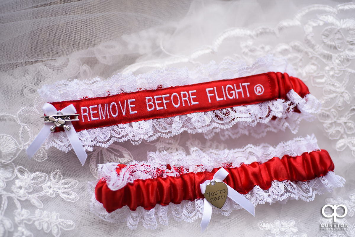 "Garters that are adorned with ""remove before flight""."