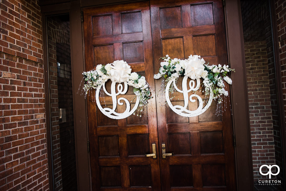 Monograms and flowers on the church doors.