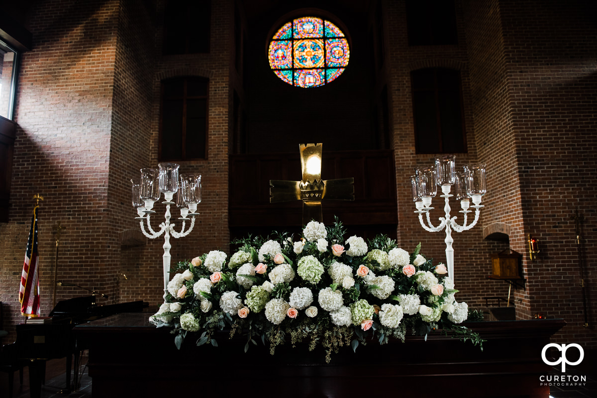 Wedding flowers on the alter.