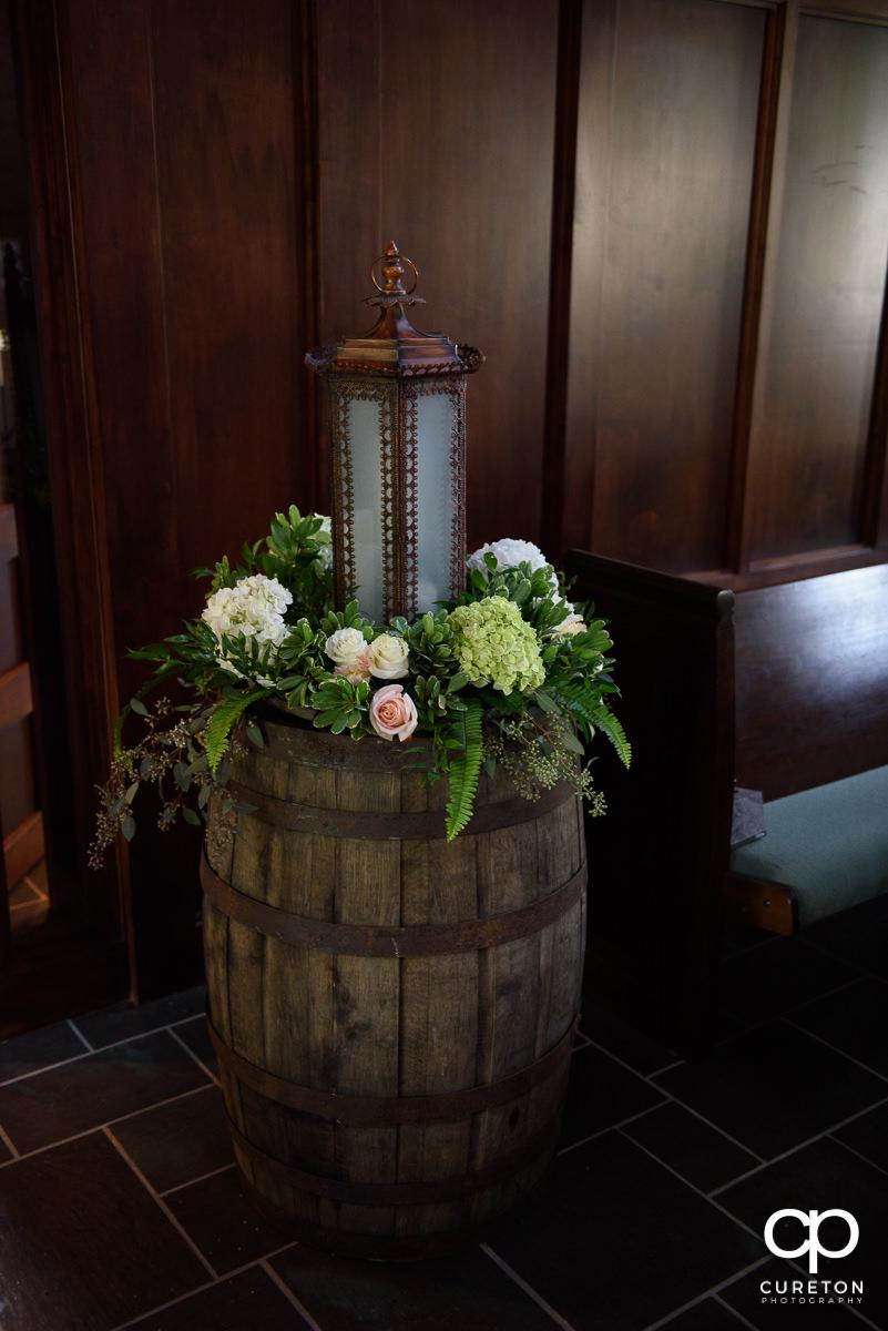 Floral arrangement on a barrel.