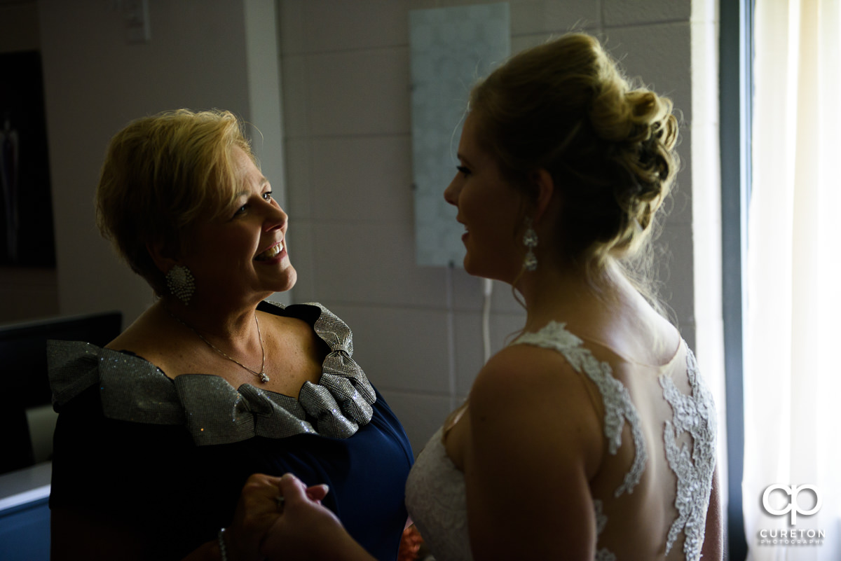 Bride and her mom sharing a moment before the wedding ceremony.
