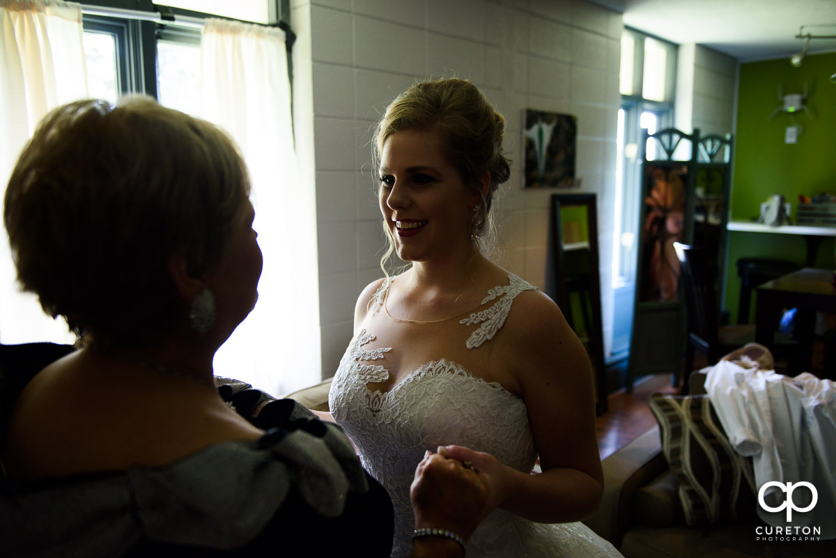 Bride looking at her mom before her wedding ceremony.