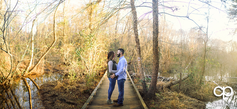 Panorama of a couple during their Lake Conestee Nature Park engagement session.