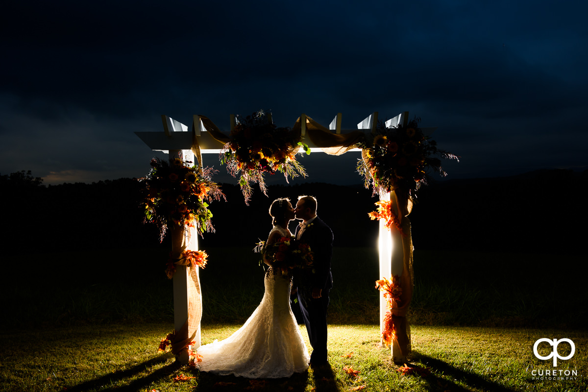 Backlit photo of a married couple at their Lindsey Plantation wedding.