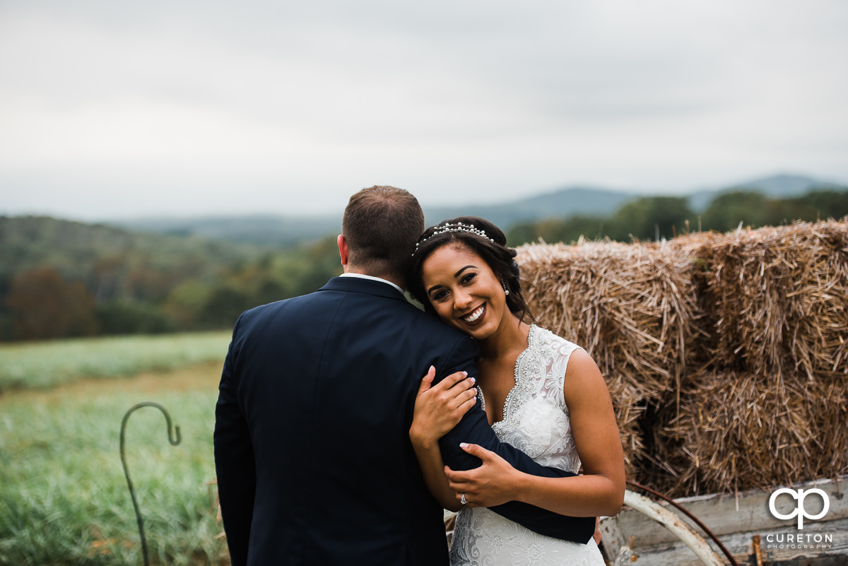 Bride holding her groom's arm.