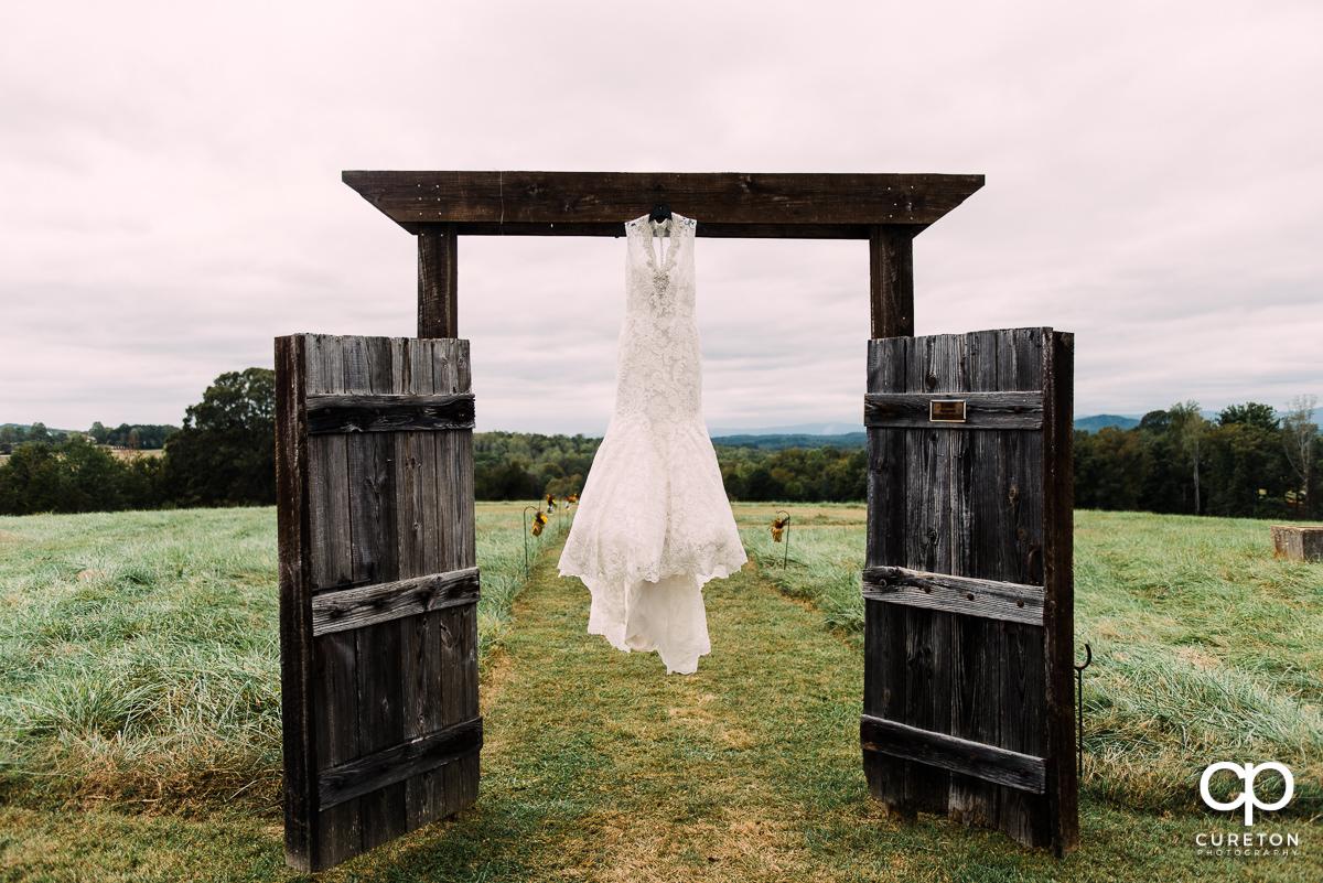 Bride's dress on rustic doors.