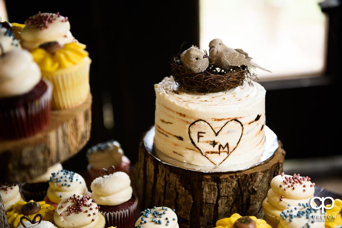 Bird's nest on top of a wedding cake.