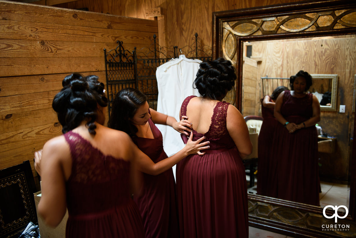 Bridesmaids getting ready.