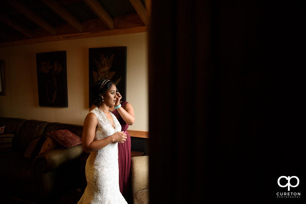 Bride putting in her earrings.
