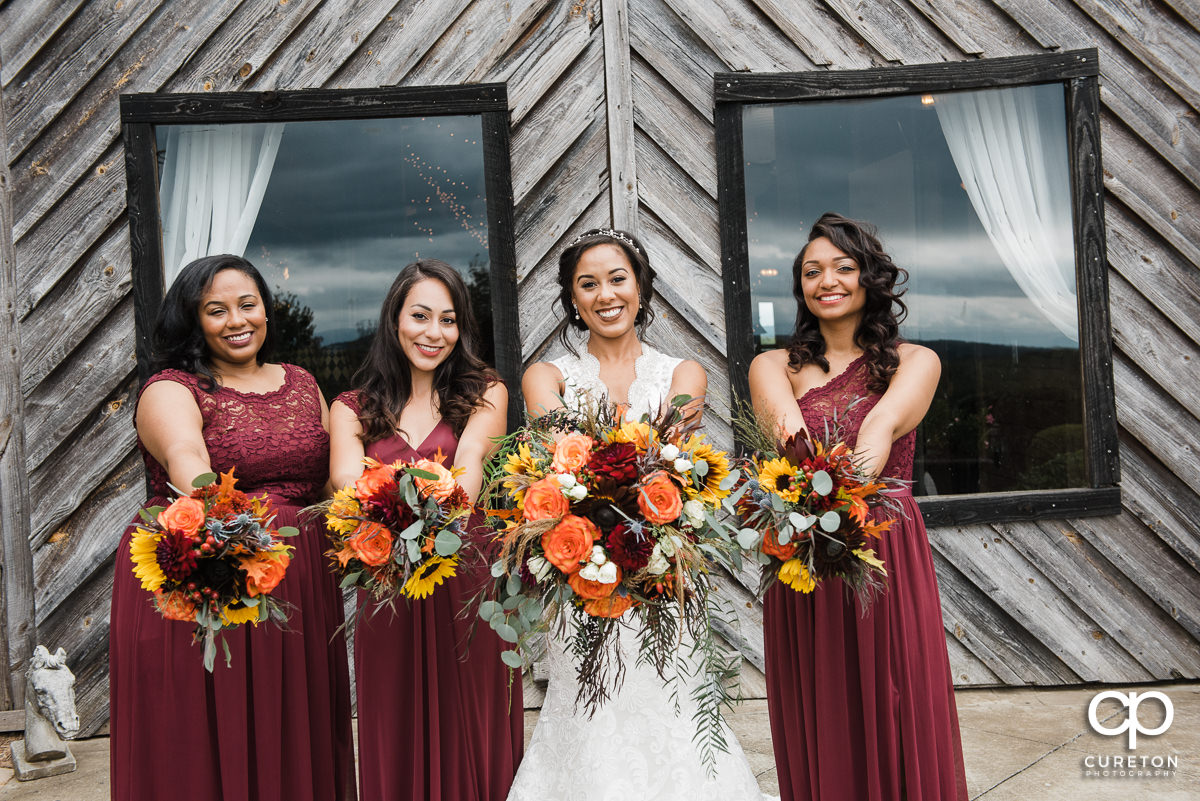 Bride and bridesmaids with amazing fall florals before the wedding.
