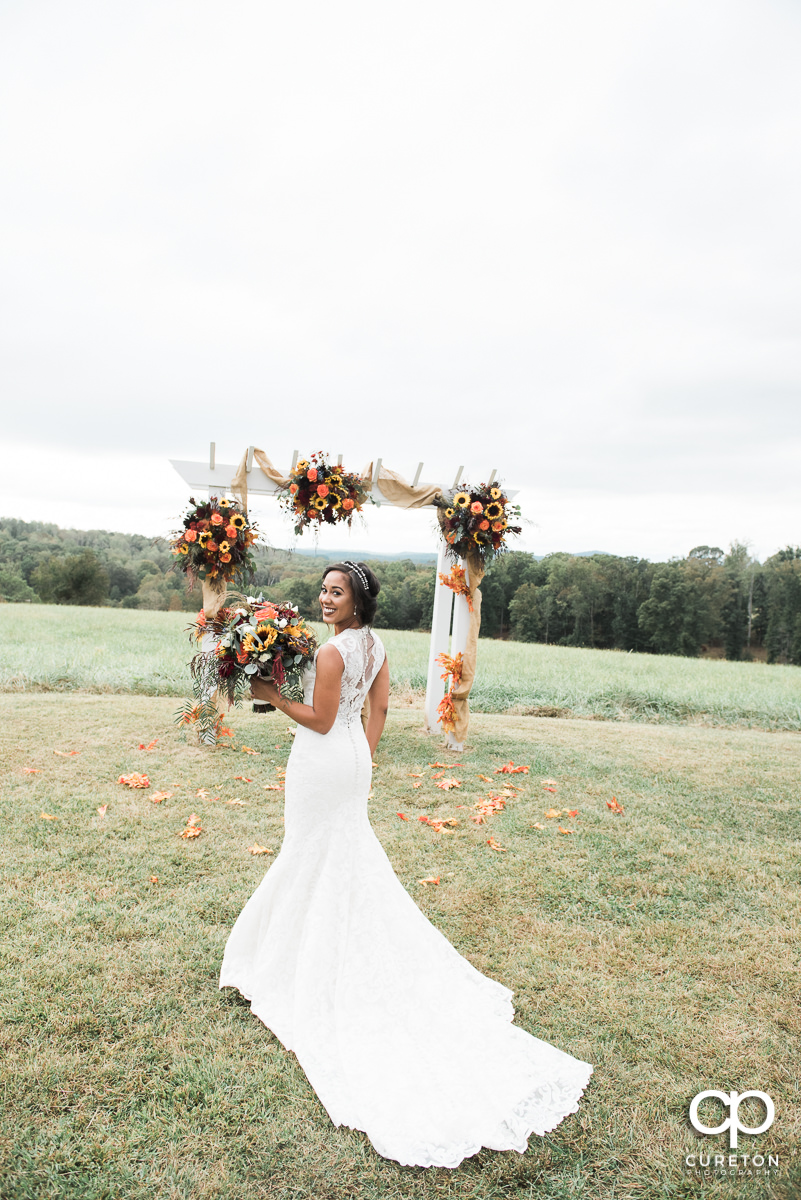 Bride with a gorgeous fall bouquet before her fall wedding at Lindsey Plantation in Taylors,SC.