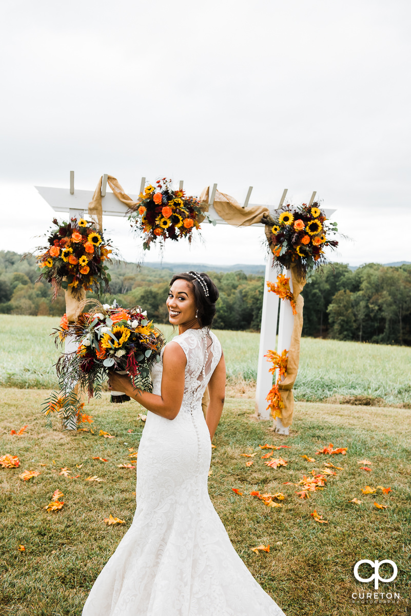 Bride an fall flowers before hwe wedding at Lindsey Plantation in Taylors,SC.