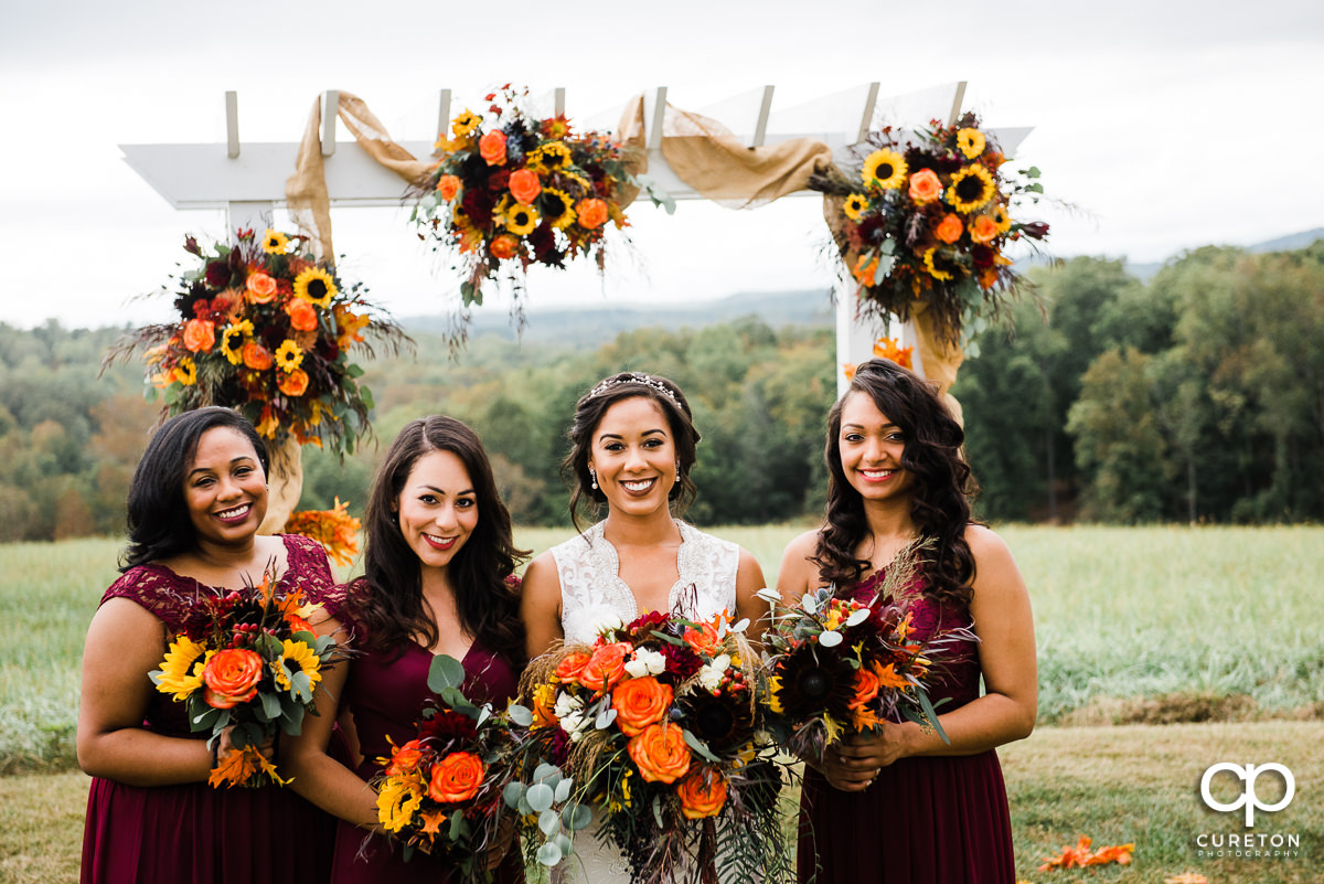Bride and bridesmaids in the field.
