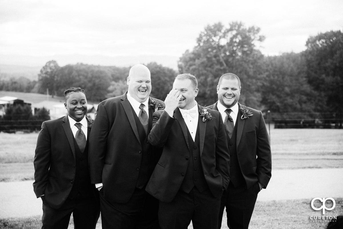 Groomsmen laughing.