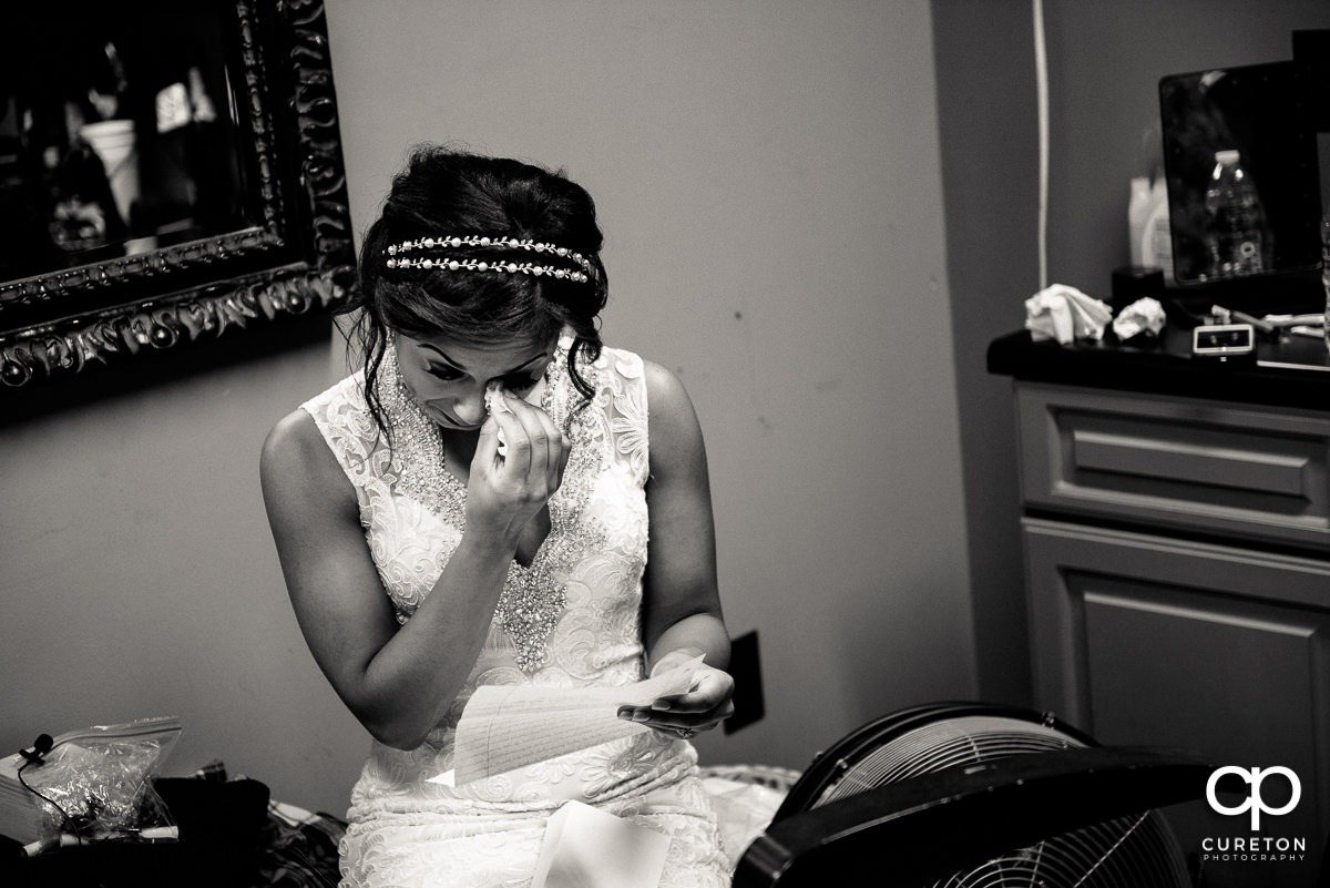 Bride tearing up when she received the groom's wedding gift.