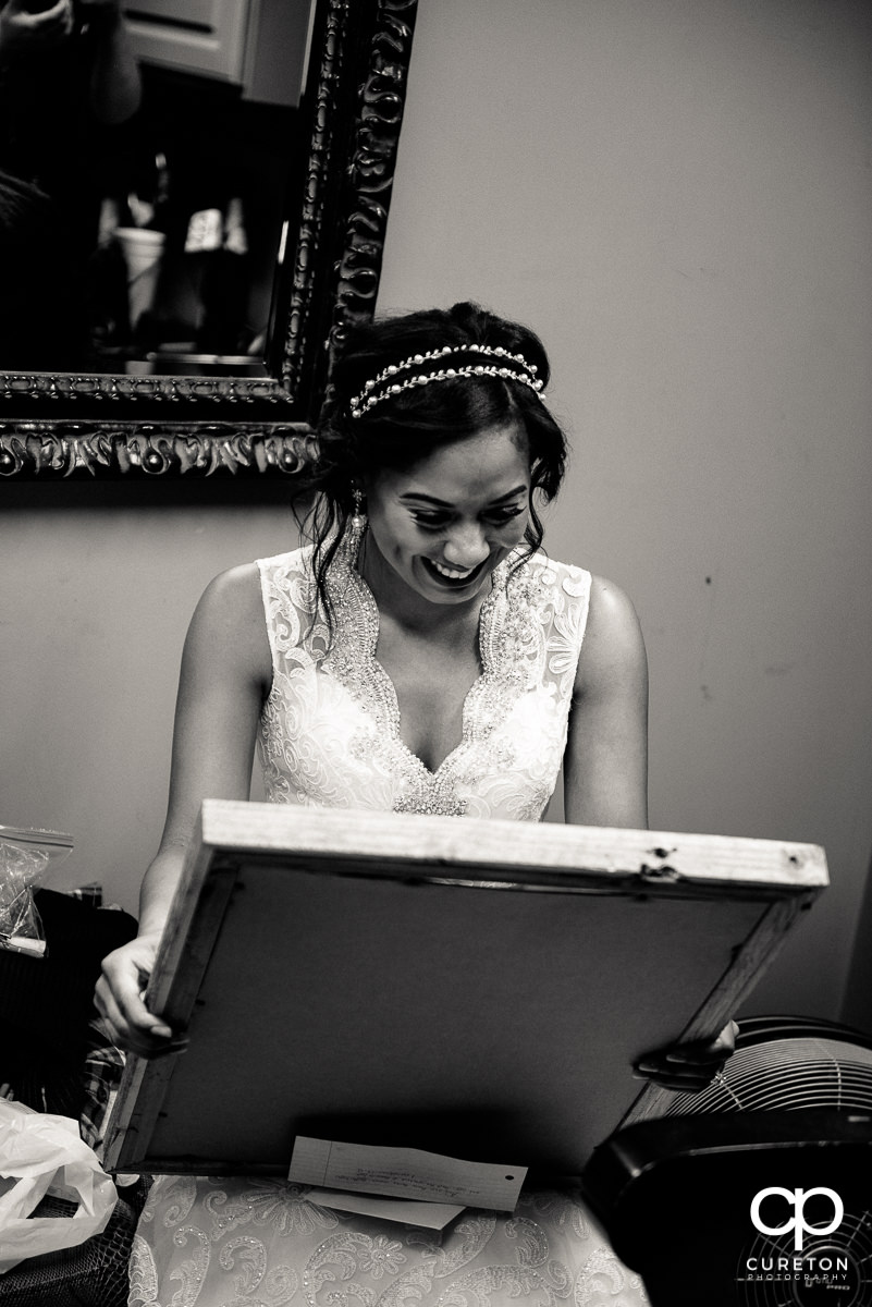 Bride happy looking at her gift.