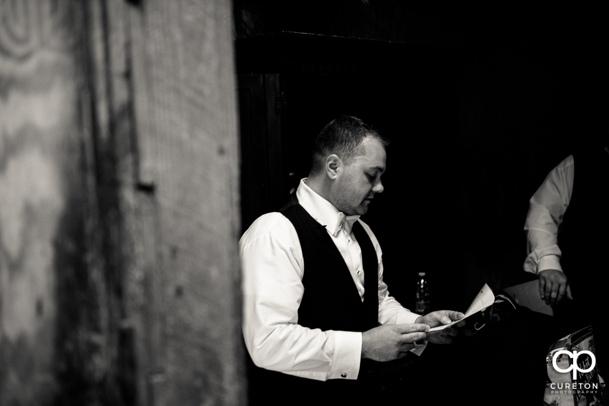 Groom reading a letter from his wife.