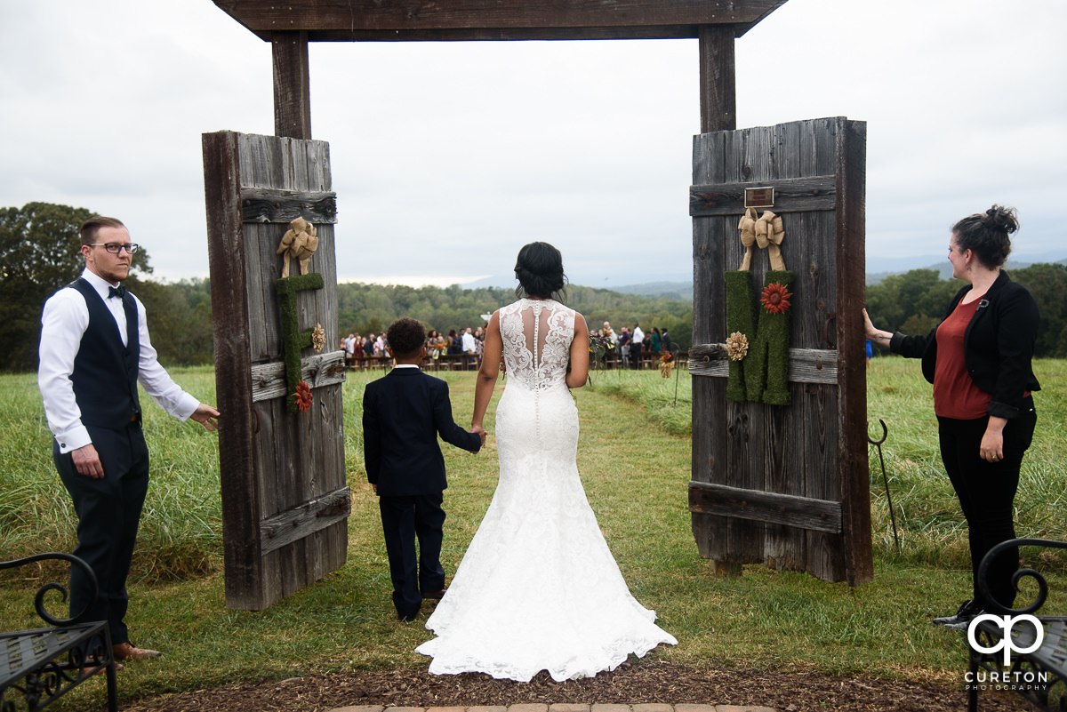 Bride and her son walk down the aisle at Lindsey Plantation.