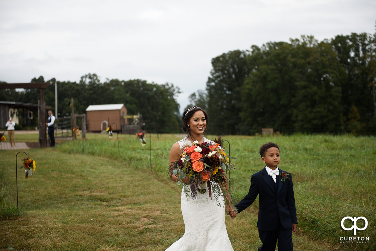 Bride and son walking down the aisle.