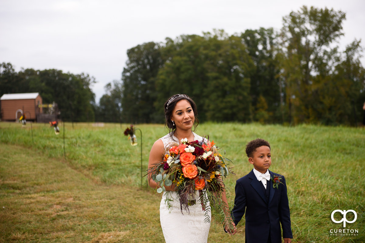 Bride sees her husband as she walks down the aisle.