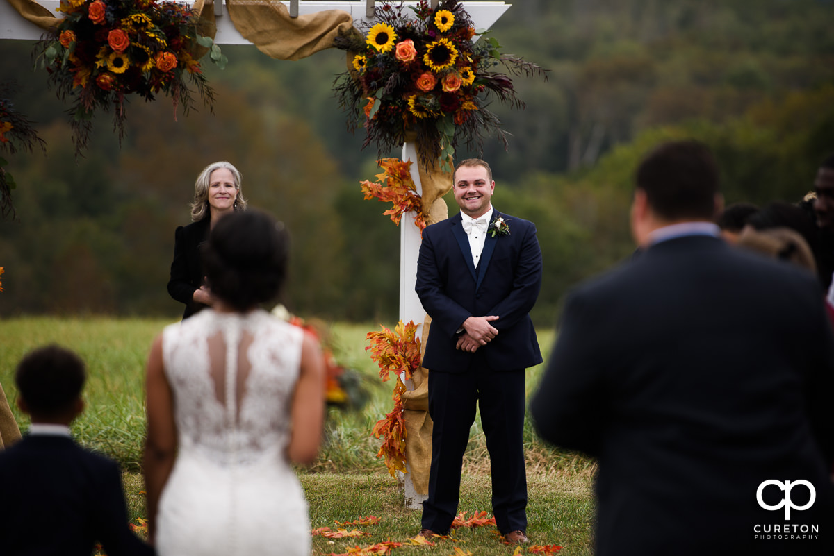 Grooms reaction as he sees his bride walking down the aisle at their fall wedding at Lindsey Plantation in Taylors,SC.