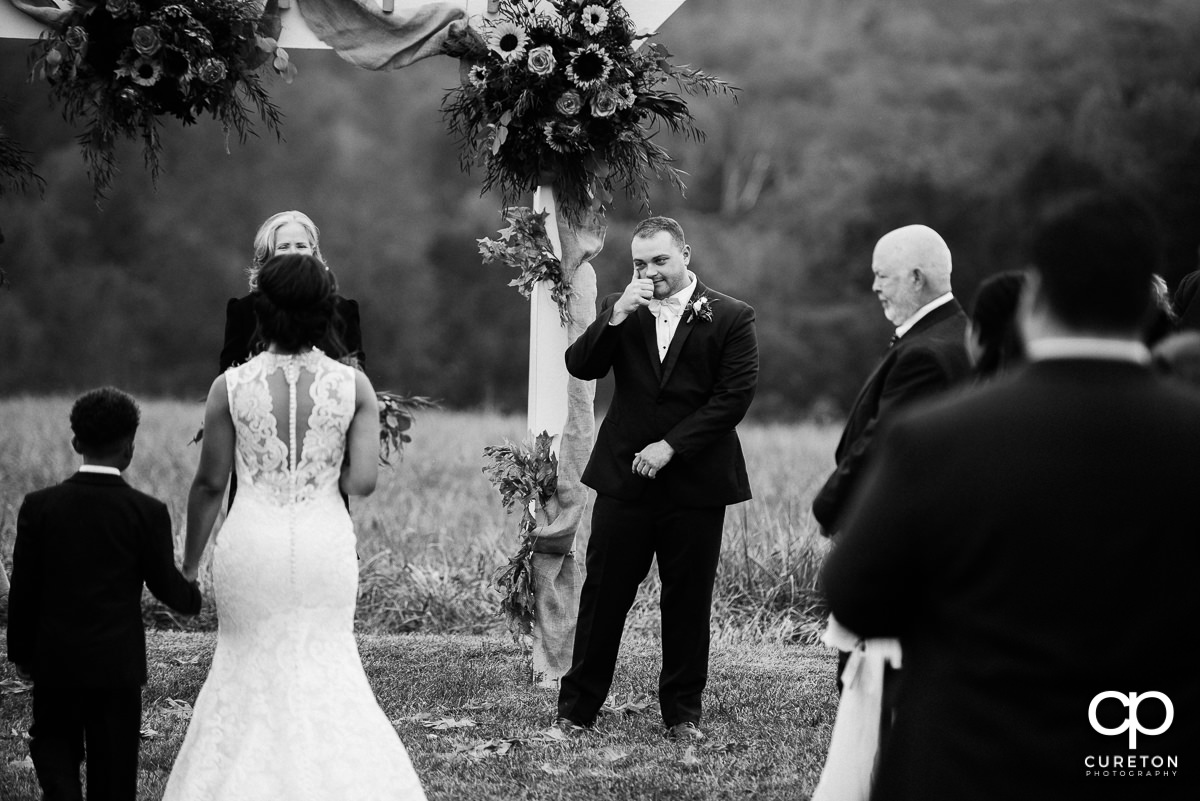 Groom tears up seeing his bride for the first time.