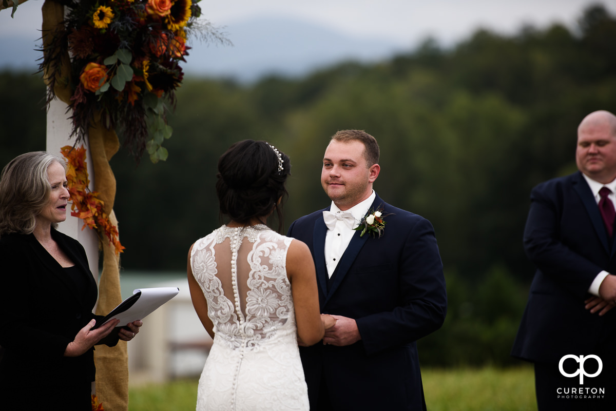 Groom looking at his bride during the wedding ceremony.
