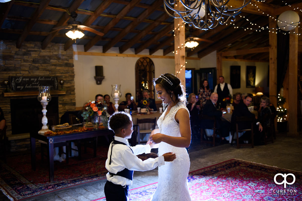Bride dancing with her son at the reception.