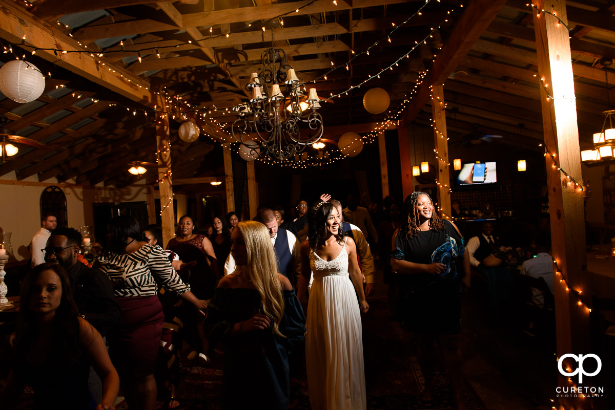 Wedding guests pack the dance floor at the reception.