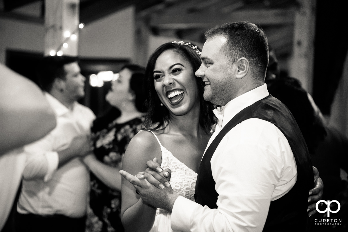 Bride and groom sharing a slow dance.