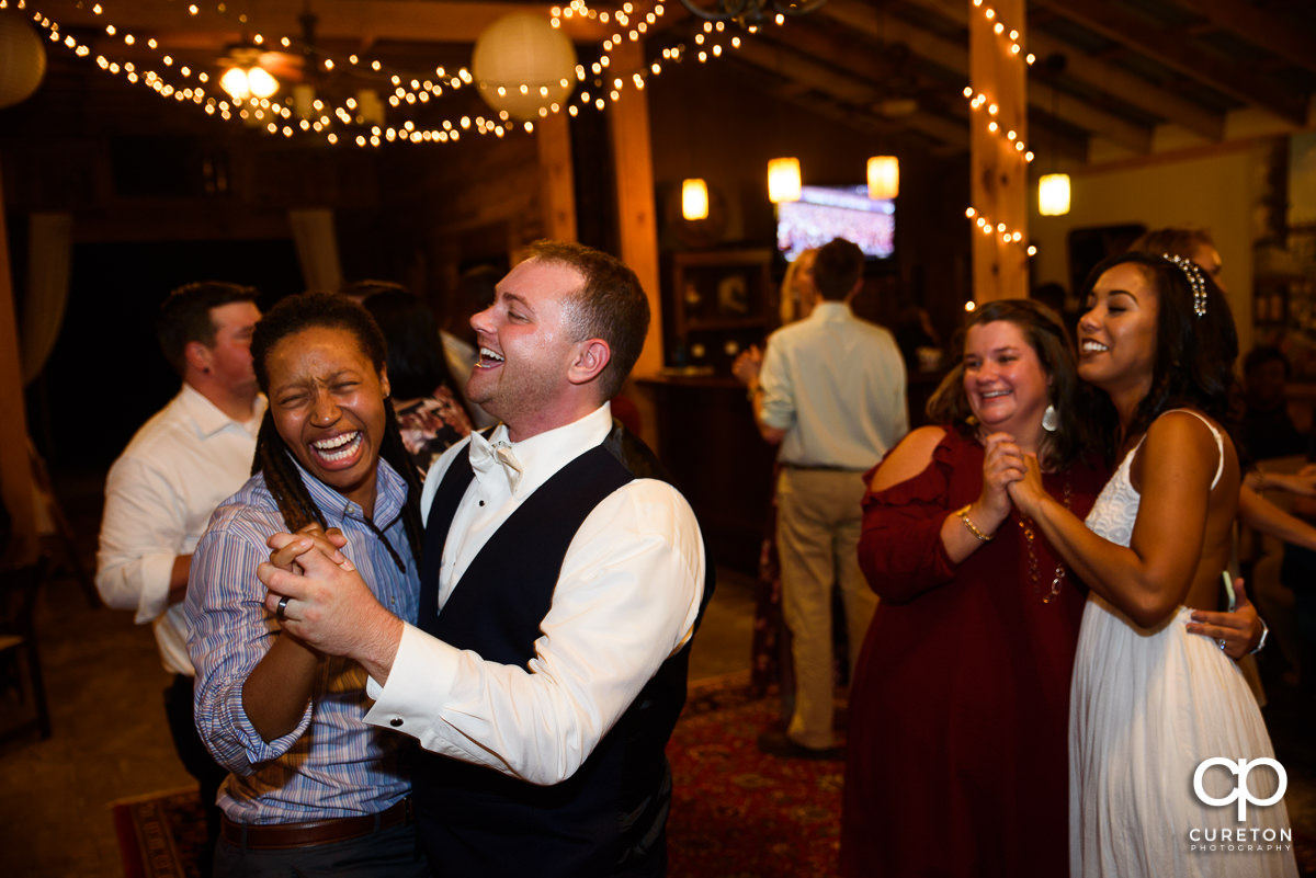 Groom dancing with a friend.