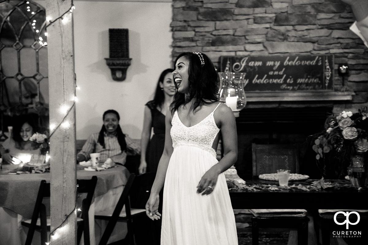 Bride laughing.