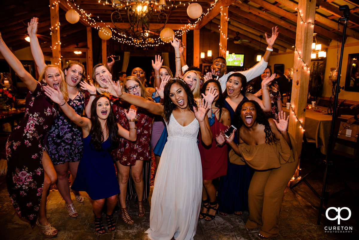 Bride and her friends cheering.