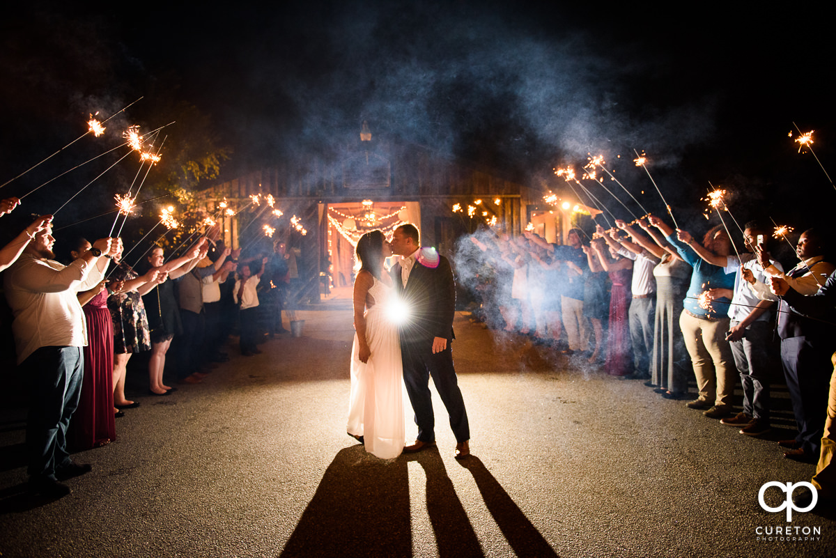 Bride and groom make a grand exit at their Lindsey Plantation wedding reception.