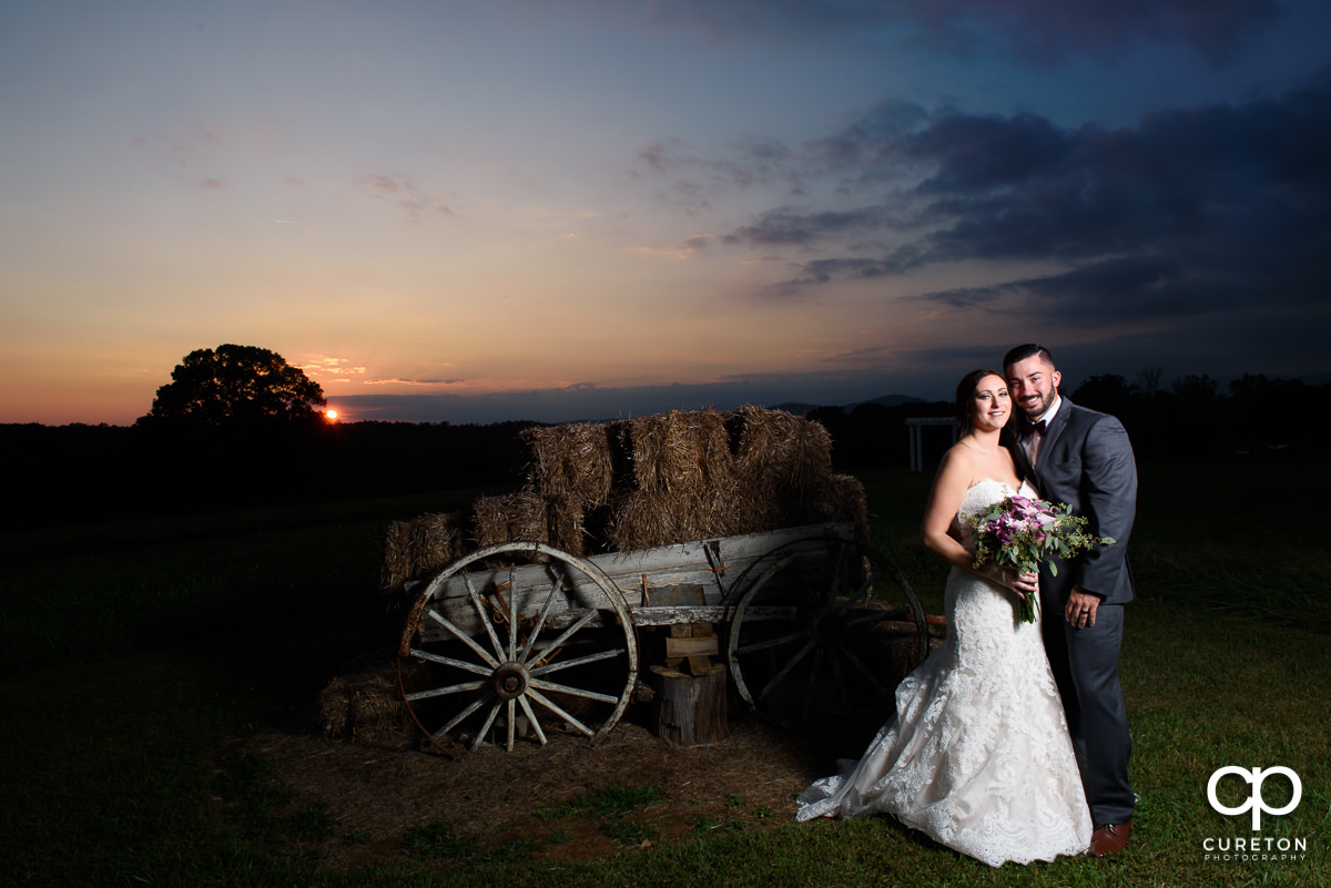 Bride and groom at sunset after their wedding at Lindsey Plantation.