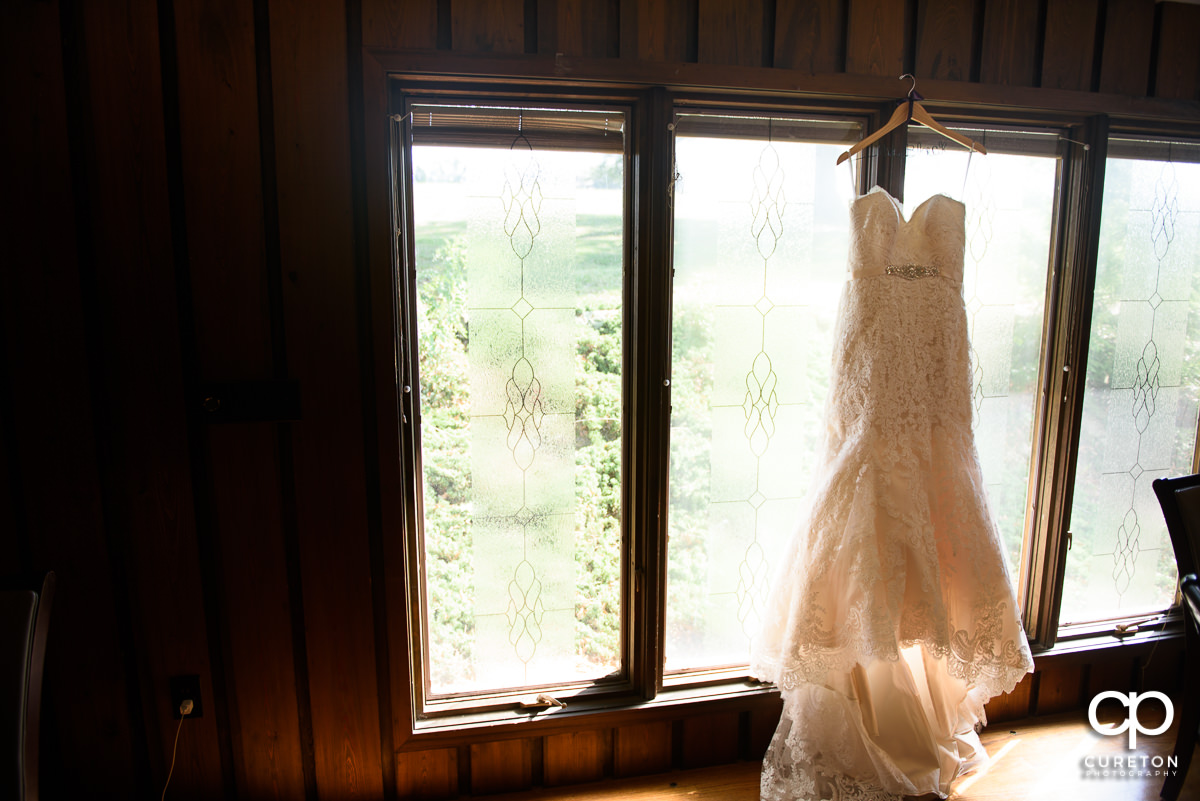 Bride's dress hanging.