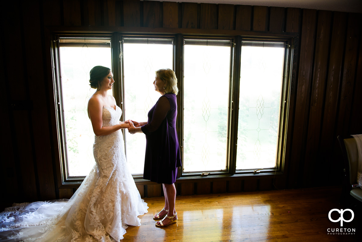 Bride and her mother sharing a moment.