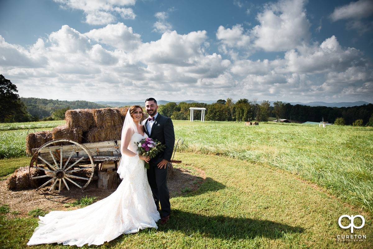 Bride and groom in the field at Lindsey Plantation.