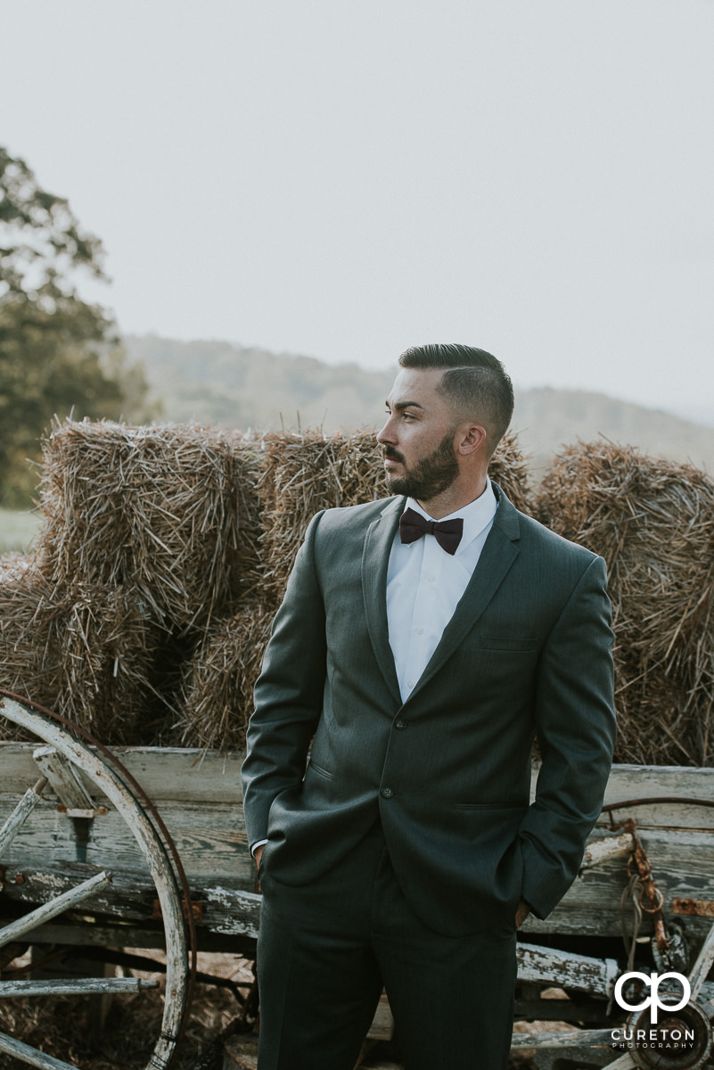 Groom in the field before his Lindsey Plantation rustic wedding.