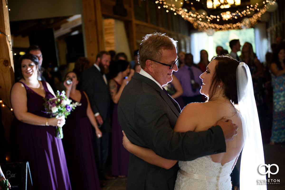 Bride and father dancing.