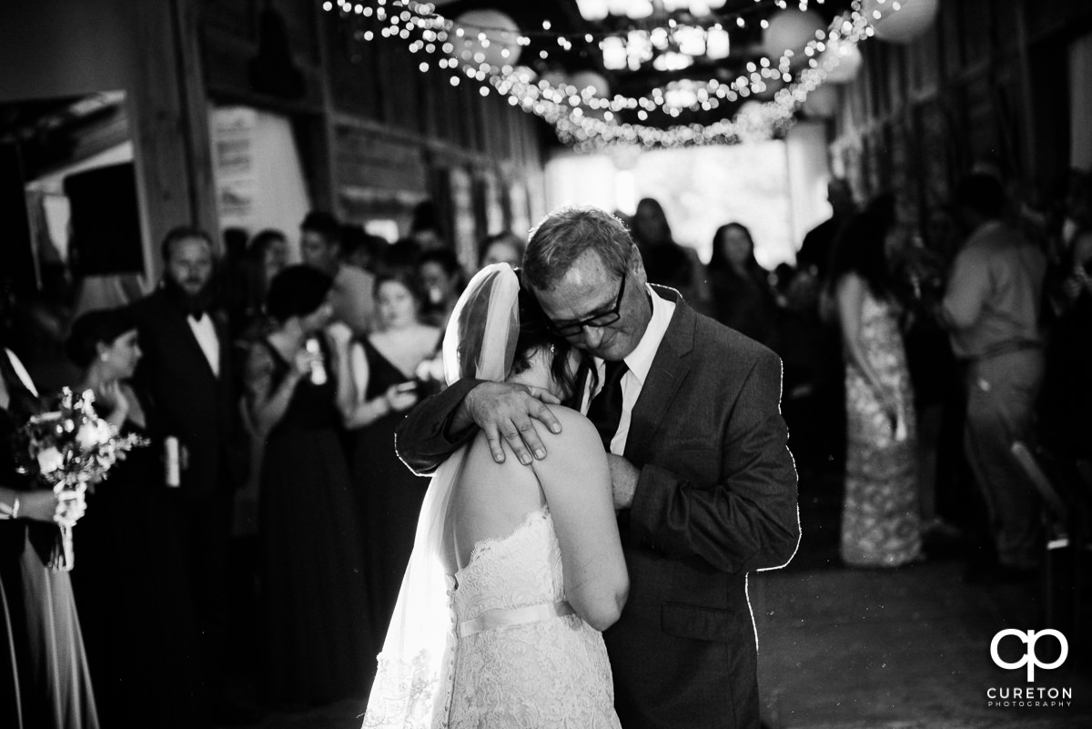 Bride and her dad share a dance.