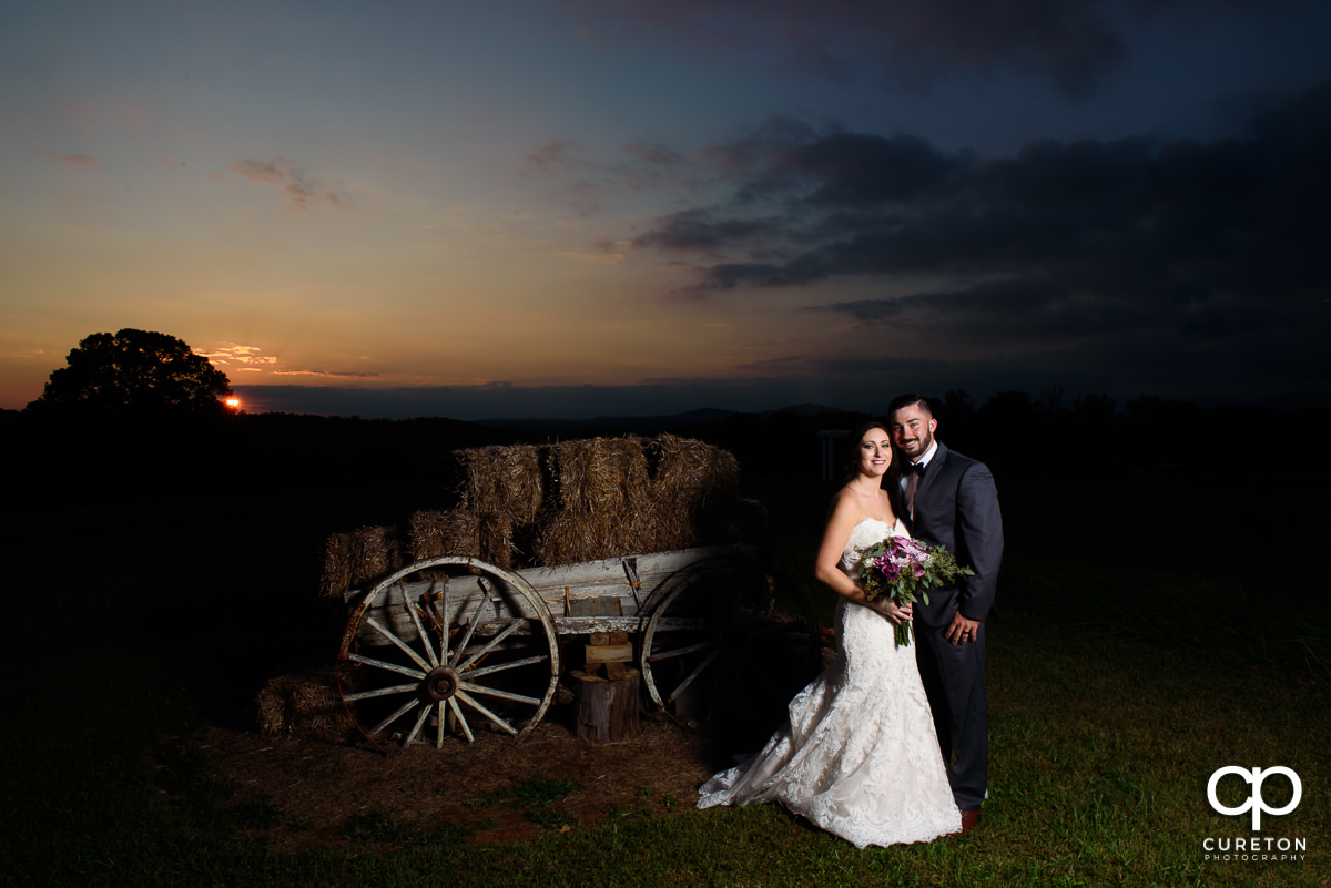 Bride and groom at sunset in the pasture at Lindsey Plantation in Taylors,SC