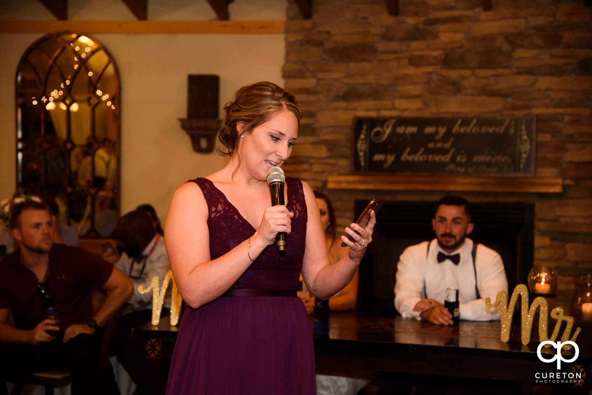 Bridesmaid giving a toast.
