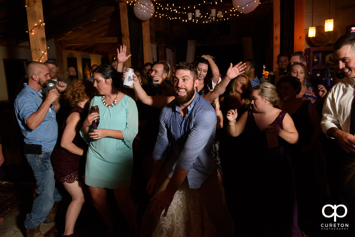 Wedding guests pack the dance floor to teh sounds of Premiere Party Entertainment.